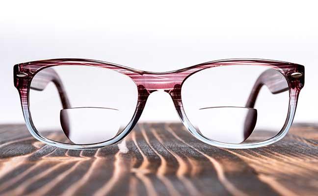 bifocal lenses glasses on a wood board